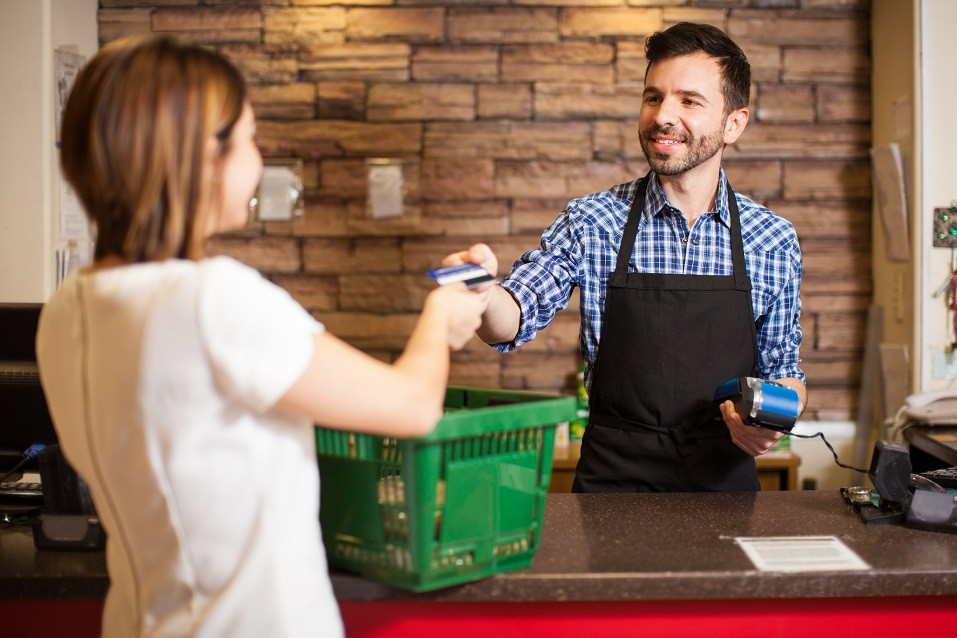 young man with a beard taking a credit card
