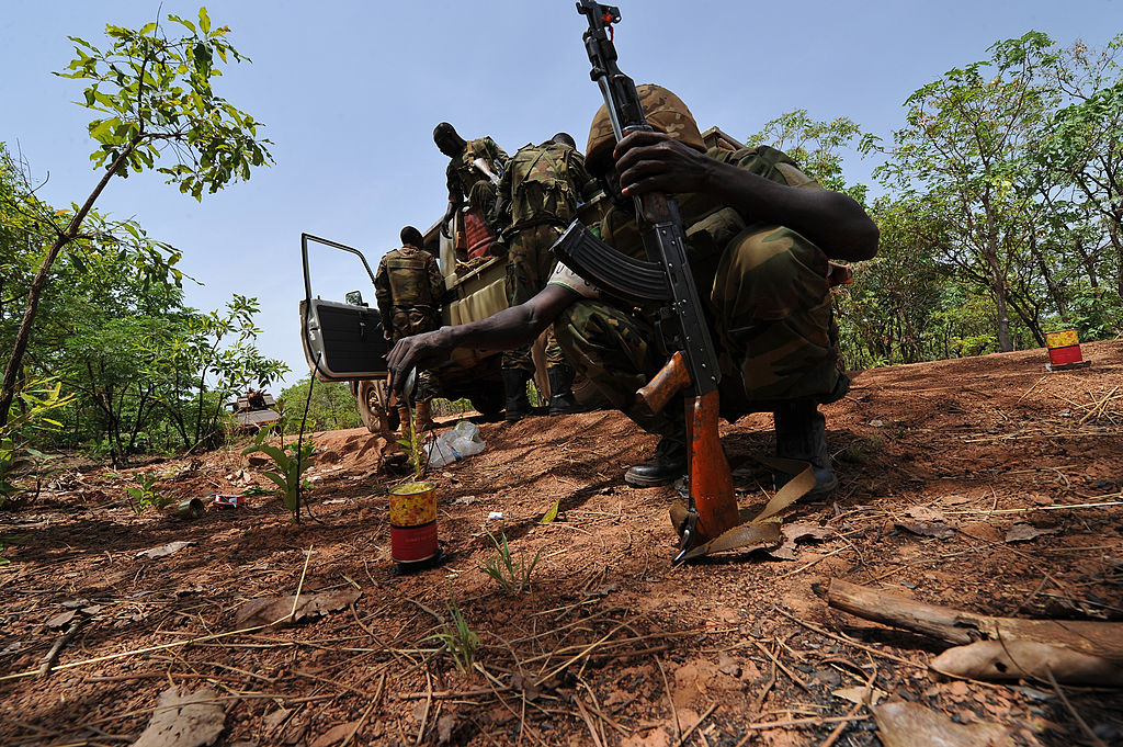 A Chadian soldier serving with the African-led MISCA force heating his daily ration during a patrol
