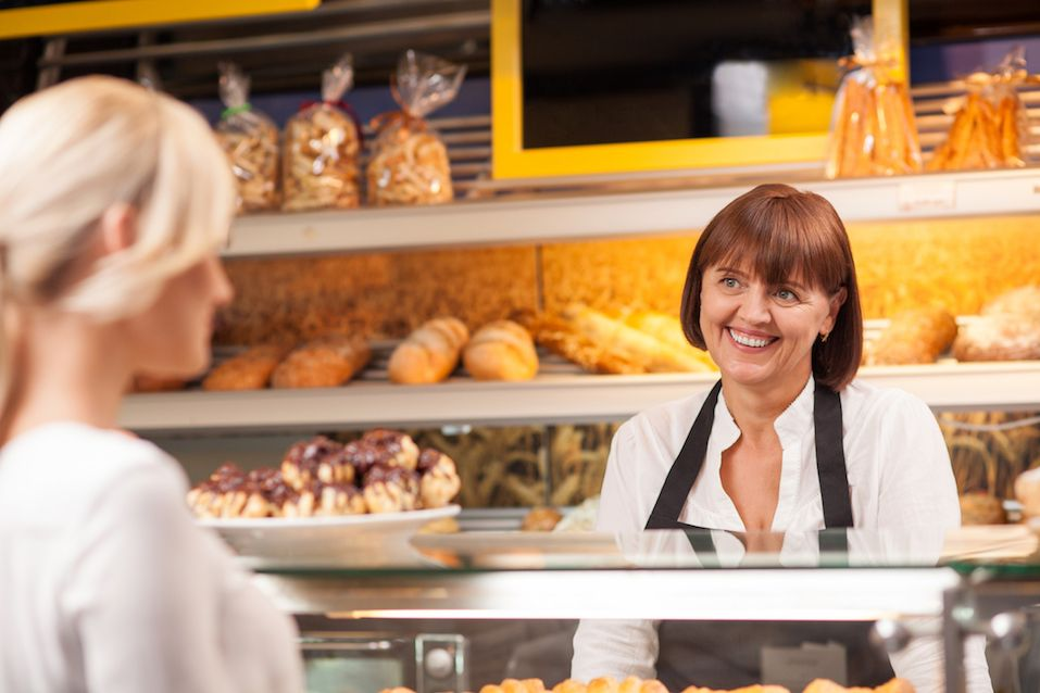 woman is buying baked products