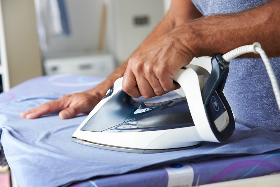 Man Ironing Laundry