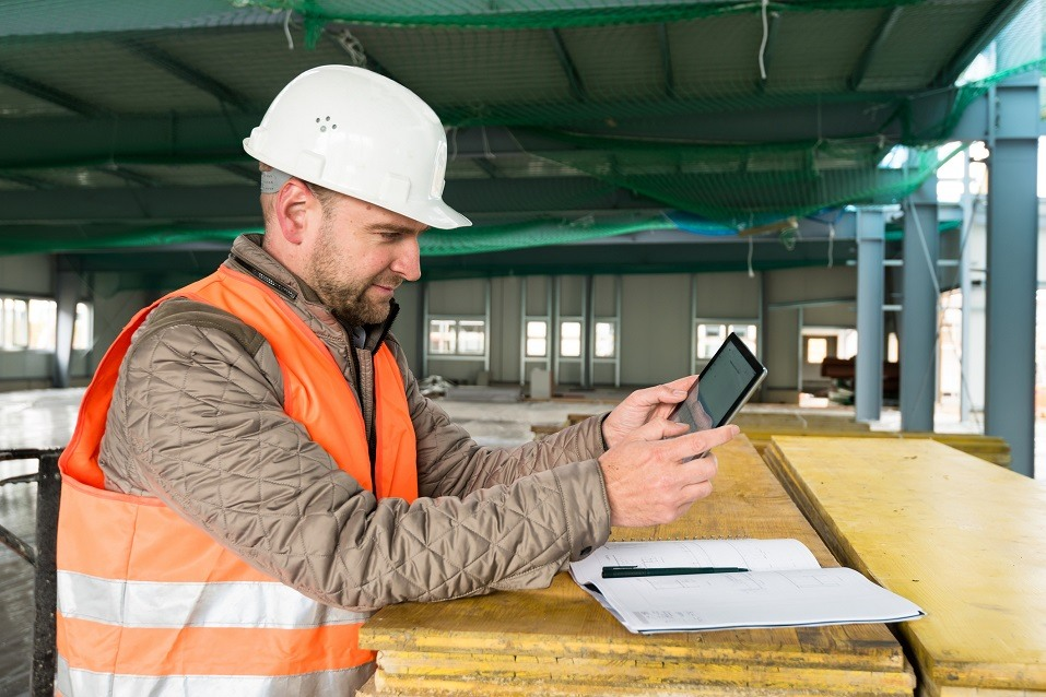 supervisor checks the interior of a new warehouse