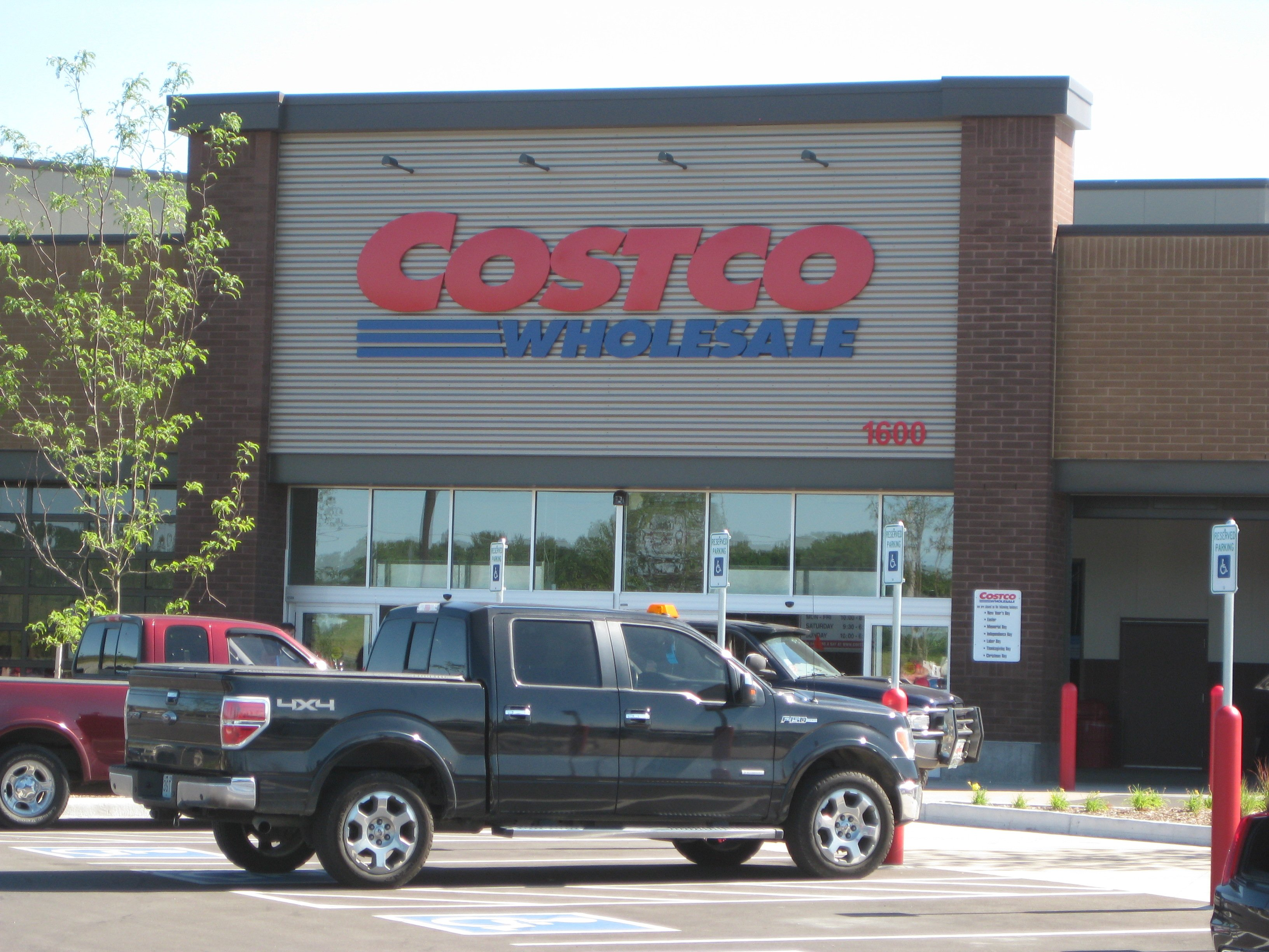 Costco storefront with a pickup truck parked