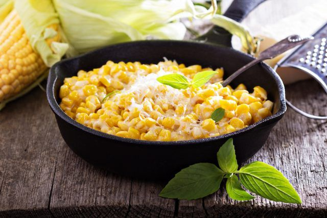 Creamy corn with cream and grated parmesan