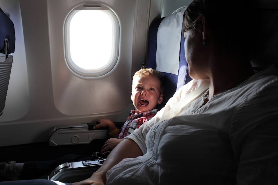 Crying boy on airplane