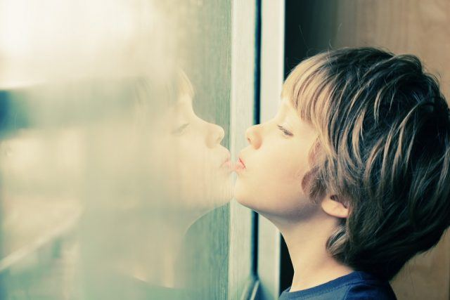boy looking through the window