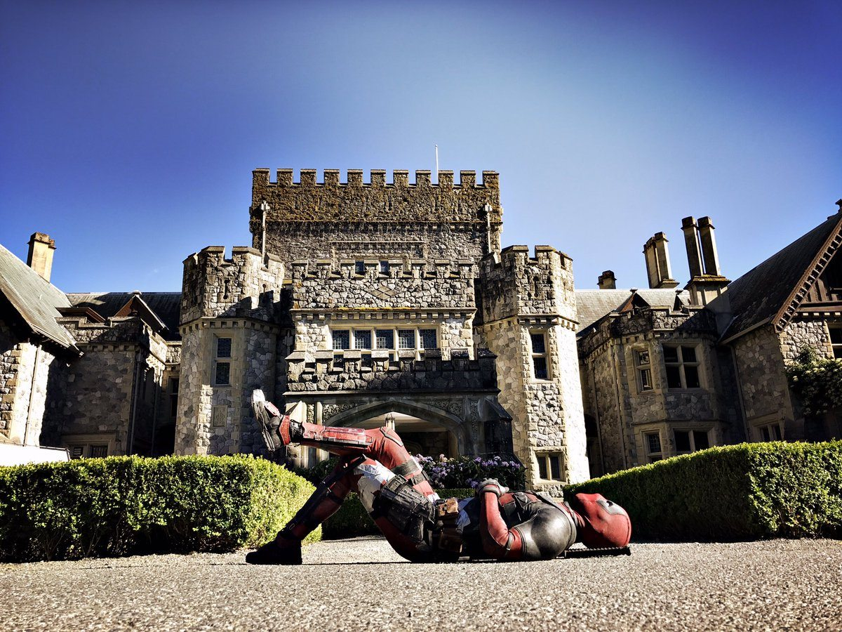 Deadpool lies in front of the X-Mansion