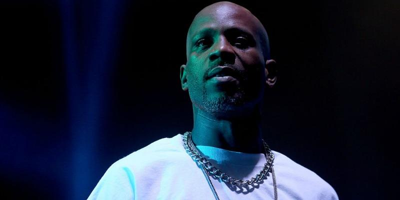 DMX is wearing white t-shirt as she stand on stage.
