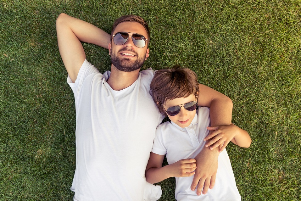 boy and his handsome young dad in white T-shirts