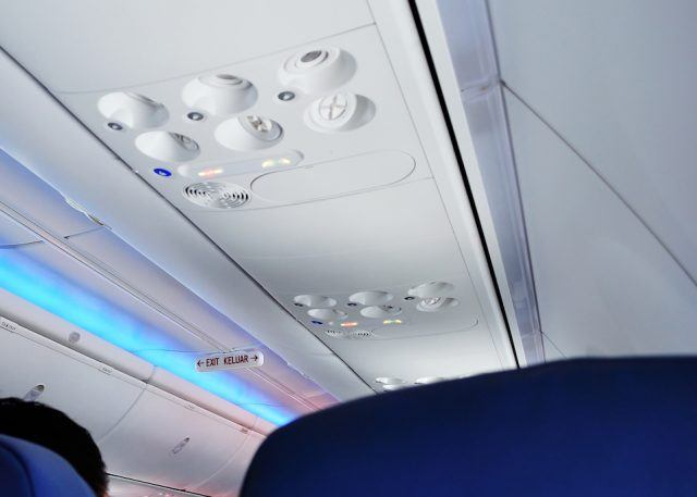 Emergency exits on the top of a plane.