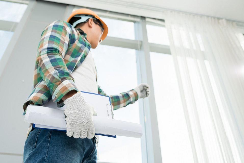Foreman examining house