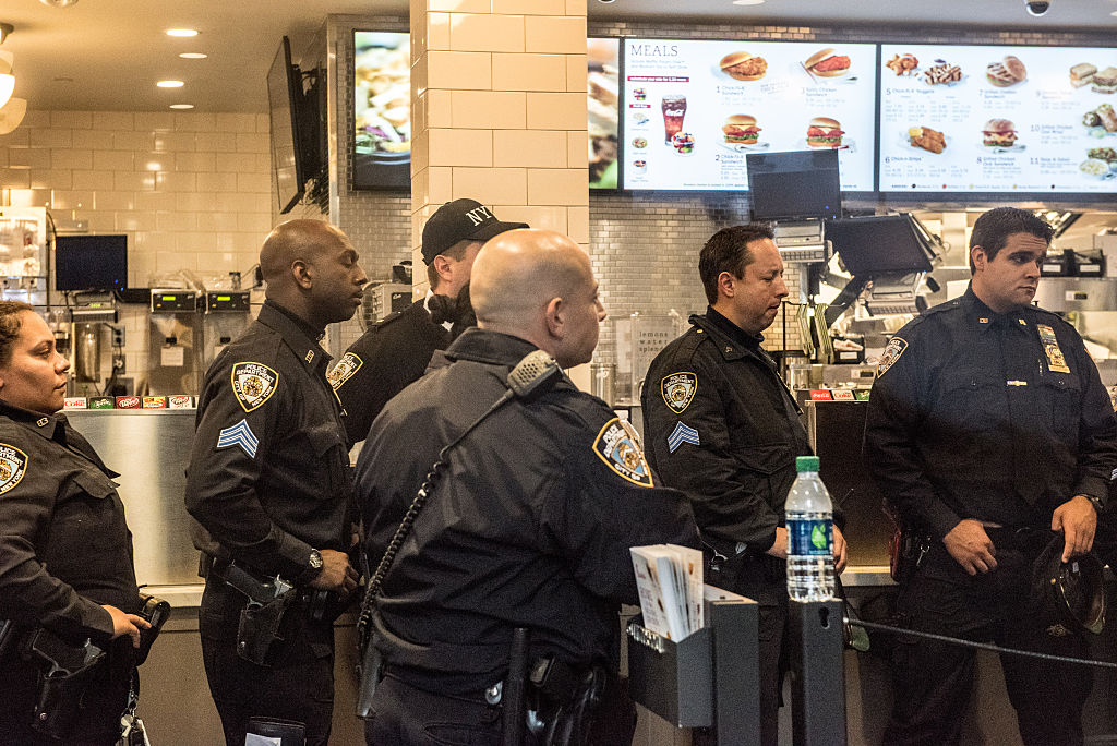 New York Police Department officers have a meeting inside of Chick-Fil-A, a day
