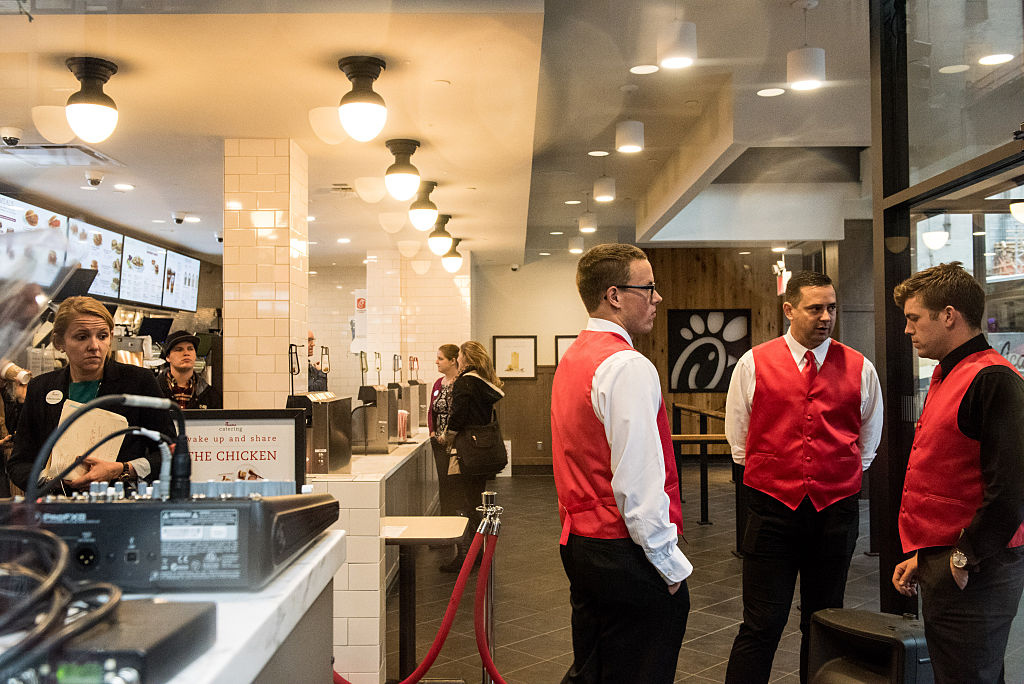Employees work inside of Chick-Fil-A, a day