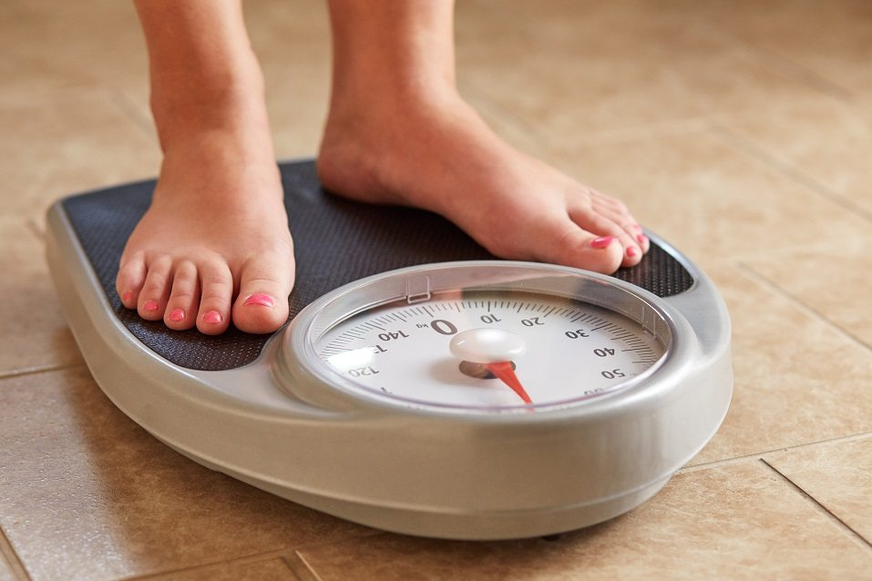 Woman weighing her weight