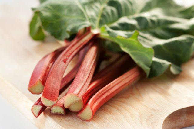 Fresh cut rhubarb laying on a table.