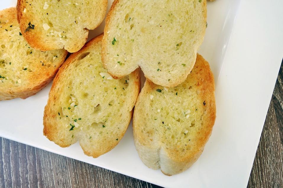 garlic bread on white plate
