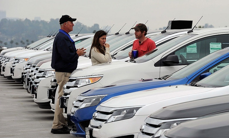 GLENDALE, CA - MARCH 23: Allen Zimney and his girlfriend Leila Alvarez, with the help of Star Ford salesman Greg Bowles, shop for a Ford Edge at the Star Ford dealership on March 23, 2012 in Glendale, California. New car sales in March are expected to top 1.4 million in the U.S., on pace for 14.6 million within the year.