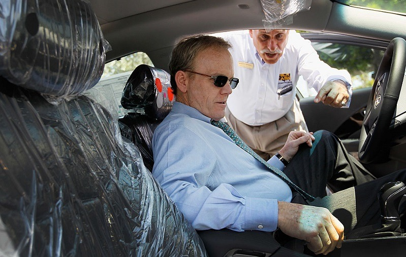 PLANTATION, FL - APRIL 03: Car salesman Marty Israel (R) helps Peter Tesche as he shops for a car at Rick Case Plantation Hyundai on April 3, 2012 in Plantation, Florida. Reports indicate that automakers expect to have sold more than 1.4 million vehicles in March, about 15 percent more than a year ago and the most since 2007.