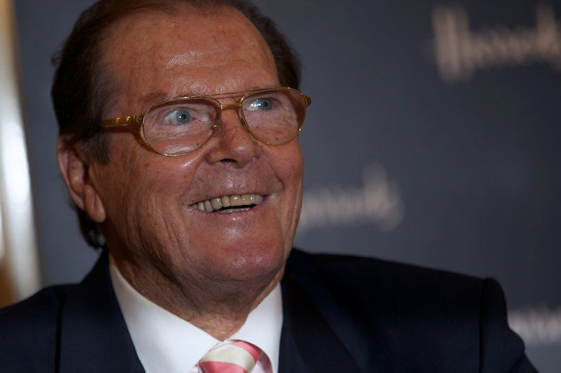 British Actor Roger Moore poses for photographs at the launch of his book Bond on Bond