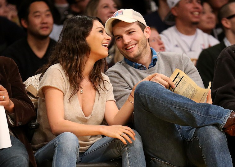 Actors Ashton Kutcher and Mila Kunis attend the game between the Oklahoma City Thunder and the Los Angeles Lakers at Staples Center