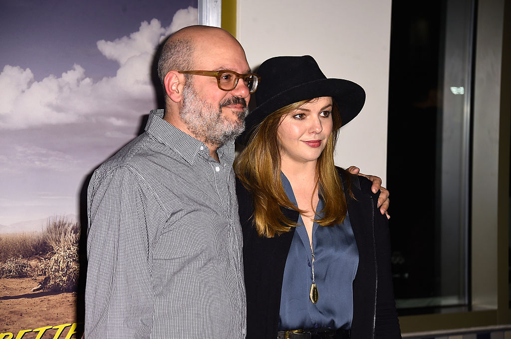 David Cross smiling, with his arm around Amber Tamblyn