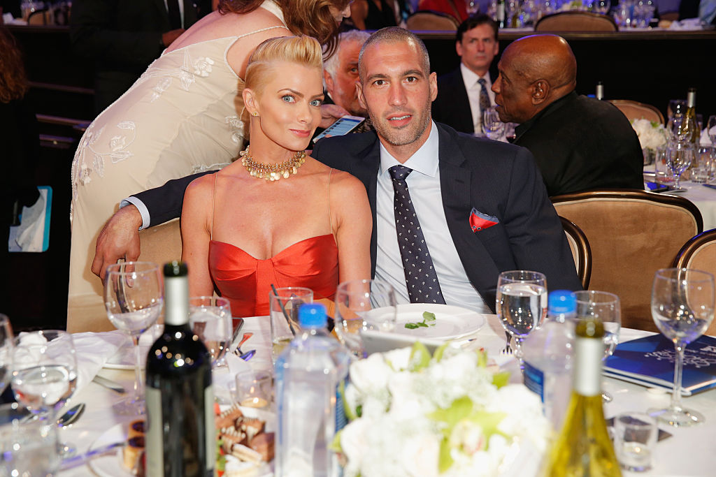 Jaime Pressly and Hamzi Hijazi , sitting at a dinner table and smiling together