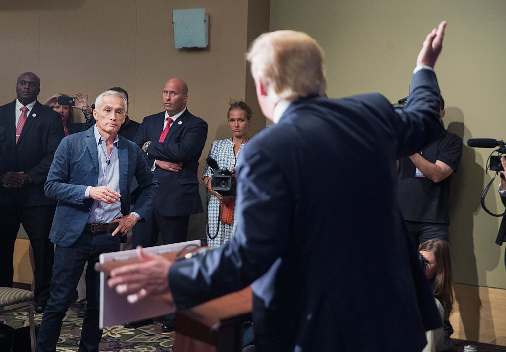 Donald Trump fields a question from Univision and Fusion anchor Jorge Ramos during a press conference