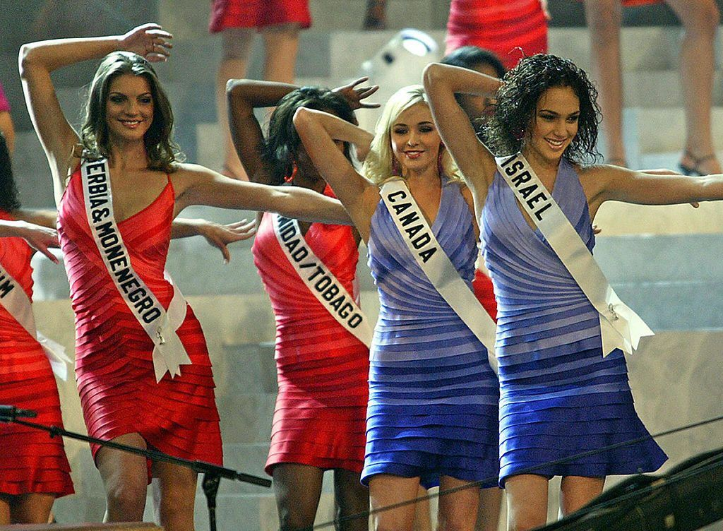 Miss Serbia & Monenegro, Miss Trinidad/Tobago, Miss Canada, and Miss Israel (Gal Gadot) dancing on stage during the Miss Universe 2004 contest