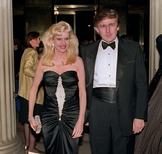 Donald Trump and his wife Ivana walking side by side at a very formal event.