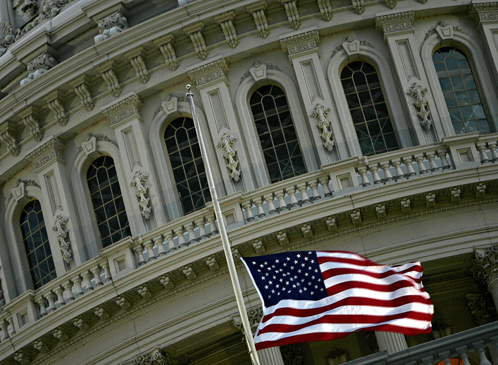 A flag flies over the U.S. Capitol.