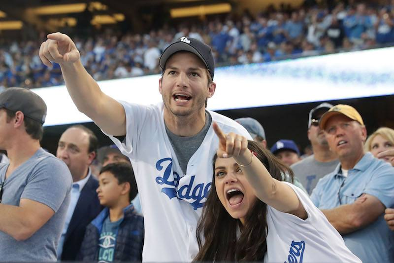 Mila Kunis and Ashton Kutcher cheer in support of the Los Angeles Dodgers