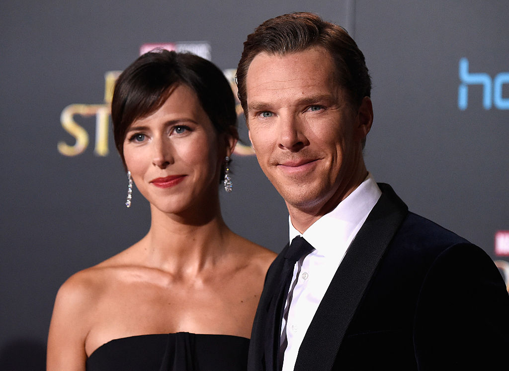 Benedict Cumberbatch and Sophie Hunter smiling together on the red carpet