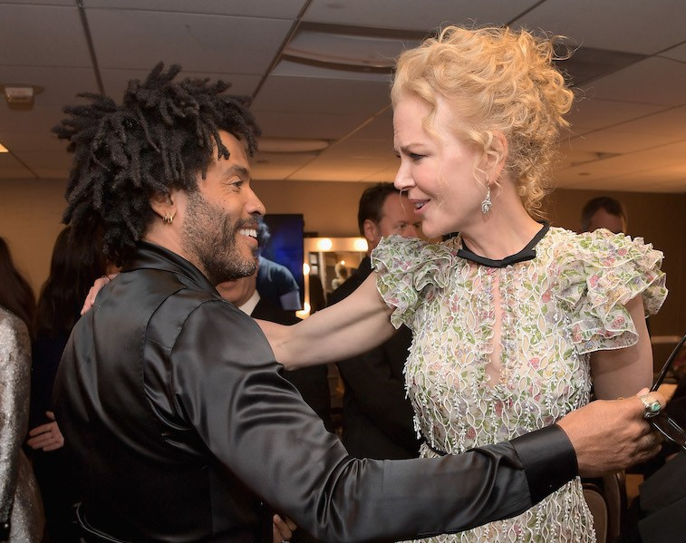 Recording artist Lenny Kravitz (L) and actress Nicole Kidman pose in the green room during the Hollywood Film Awards