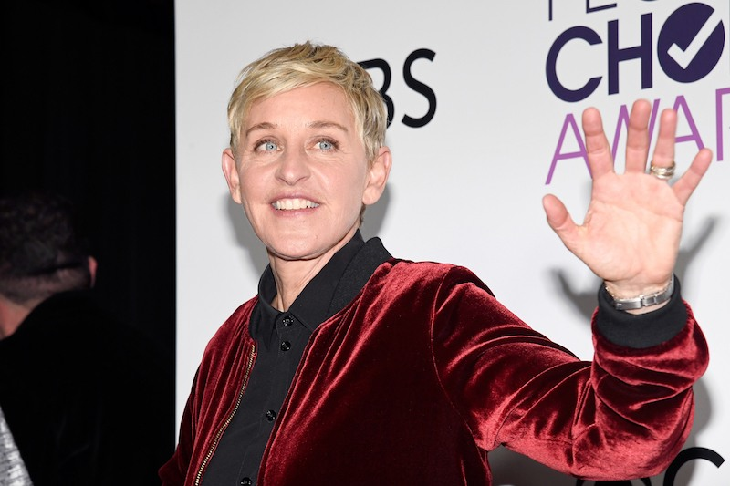 Ellen Degeneres waves in the press room during the People's Choice Awards