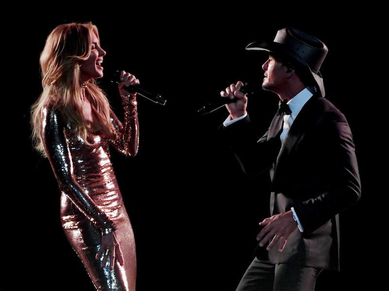Recording artists Faith Hill (L) and Tim McGraw perform during the 52nd Academy of Country Music Awards