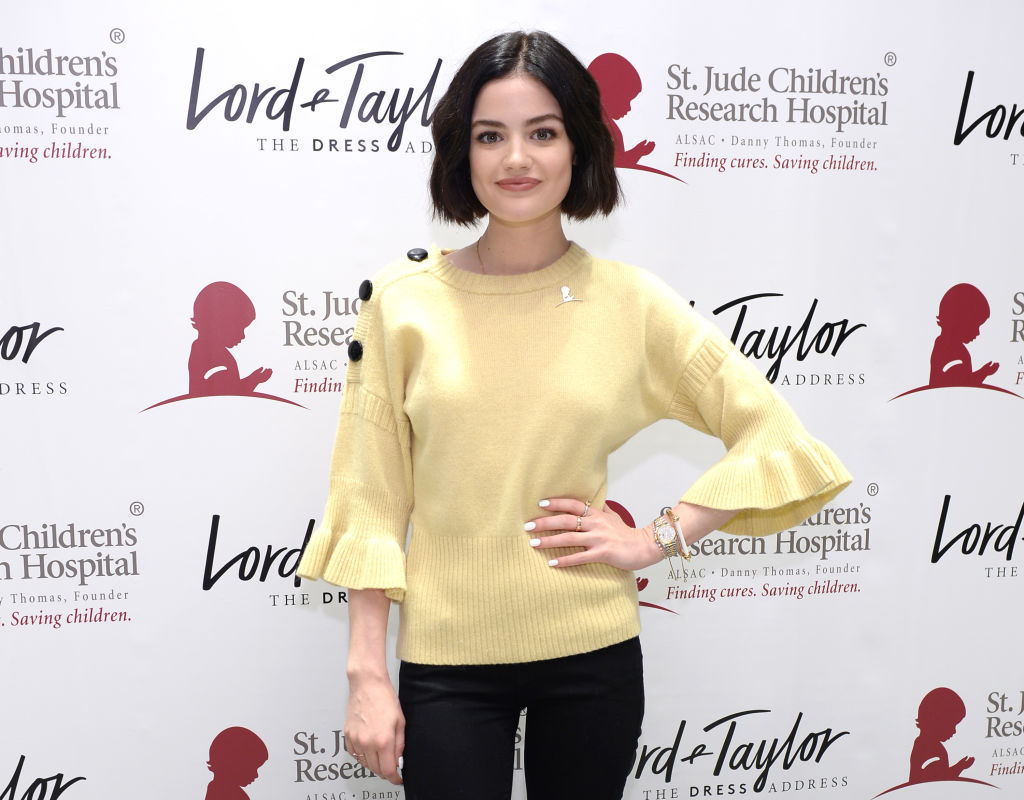 Lucy Hale poses with her hand on her hip at a Lord & Taylor event for St. Jude Children's Research Hospital