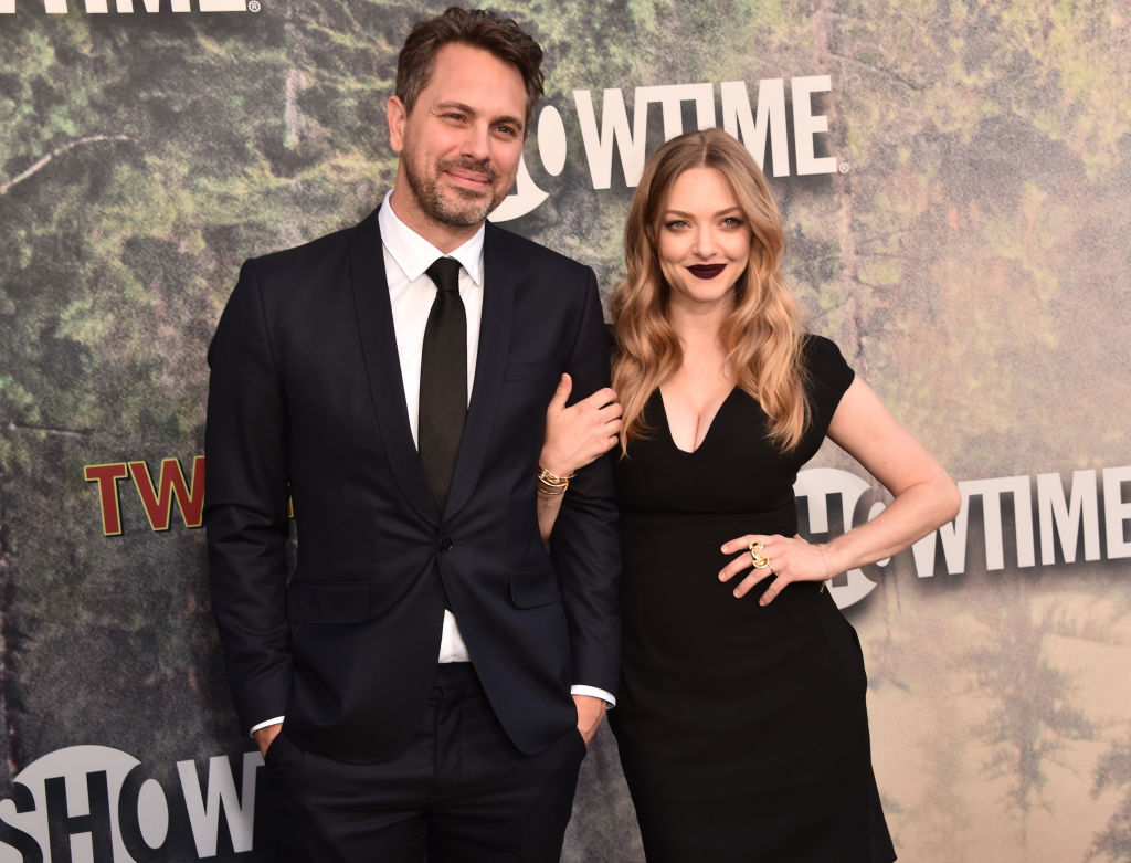 Thomas Sadoski and Amanda Seyfried smiling on the red carpet together