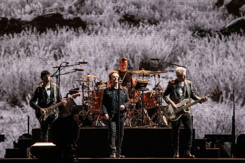 The Edge, Larry Mullen Jr., Bono, and Adam Clayton of U2 perform on The Joshua Tree Tour