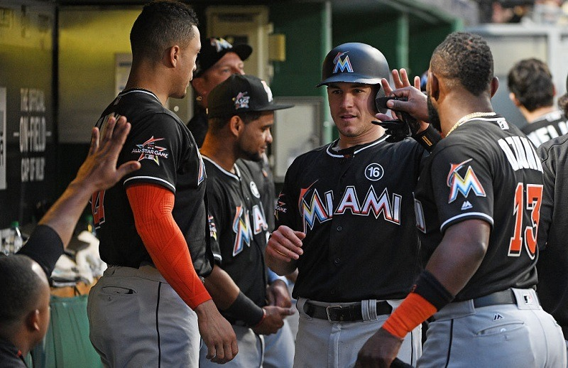 PITTSBURGH, PA - JUNE 08: J.T. Realmuto #11 of the Miami Marlins celebrates with teammates in the dugout after coming around to score on an RBI single by Tyler Moore #28 in the fifth inning during the game against the Pittsburgh Pirates at PNC Park on June 8, 2017 in Pittsburgh, Pennsylvania.