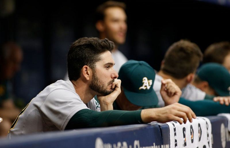 ST. PETERSBURG, FL - JUNE 11: Matt Joyce #23 of the Oakland Athletics looks on from the dugout during the ninth inning of a game against the Tampa Bay Rays on June 11, 2017 at Tropicana Field in St. Petersburg, Florida.