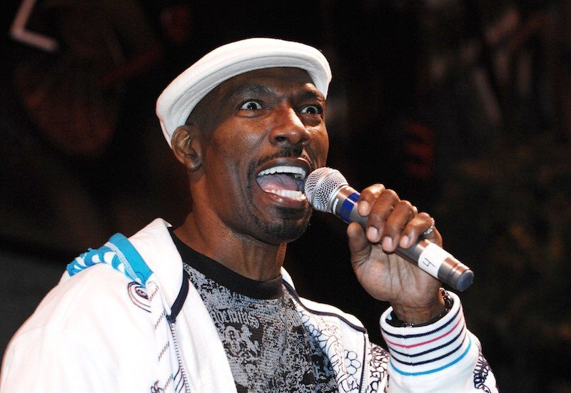 Charlie Murphy holds a microphone