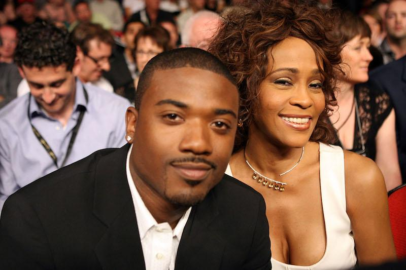 Performers Whitney Houston and Ray-J sit ringsid