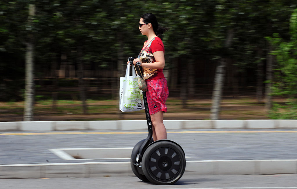 A woman commutes on a Segway to get her shopping done