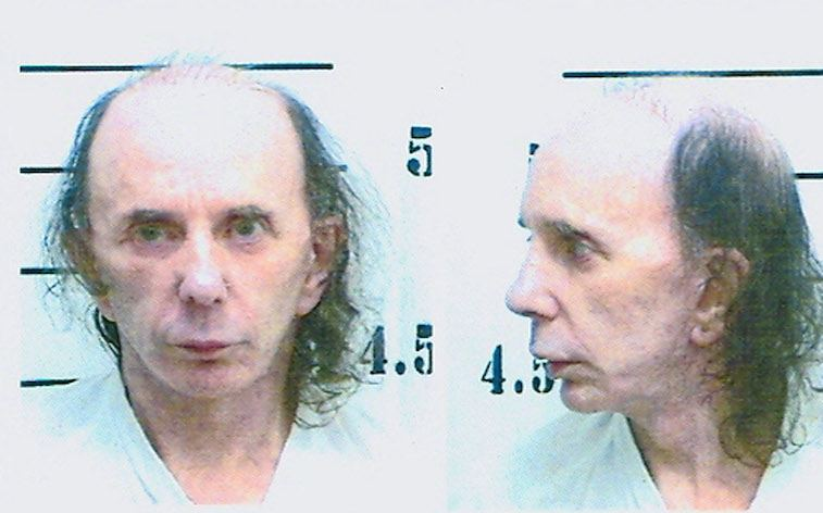 inmate Phillip Spector poses for his mugshot photo