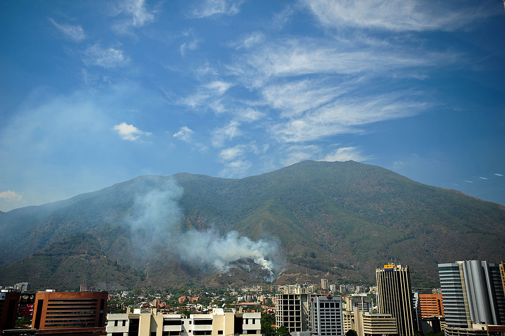 Smoke billows from El Avila National Park, as fires caused by the intense heat