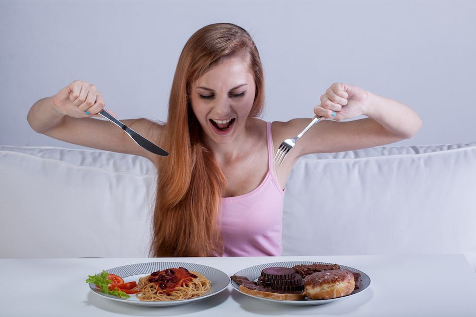 Young girl eating a lot of food
