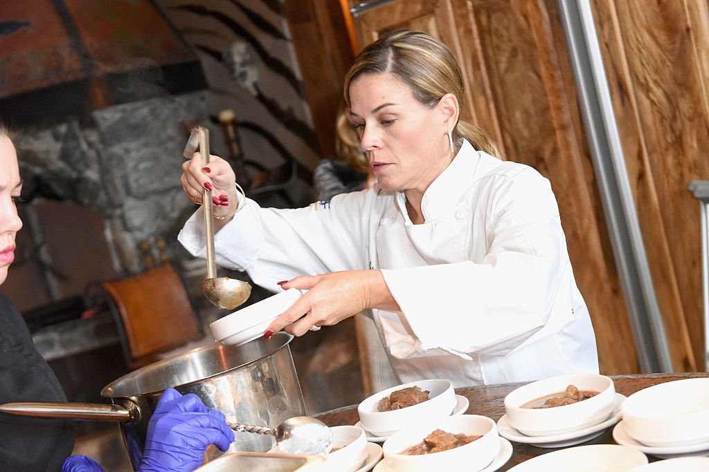 Chef Cat Cora plates food
