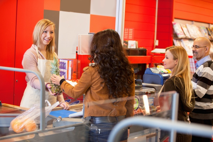 View of happy shop assistant with customer