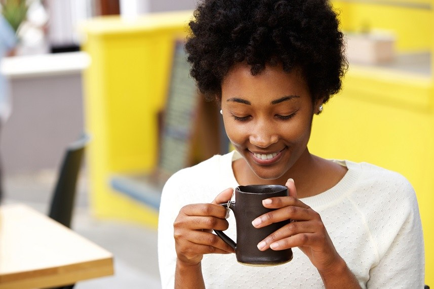 young black woman drinking coffee