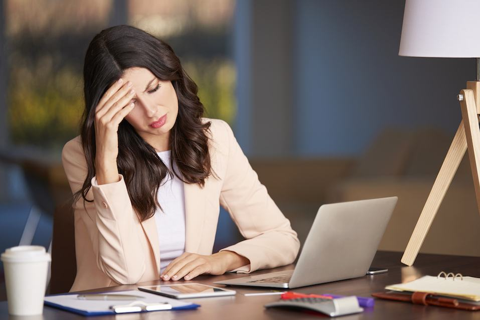 young businesswoman looking stressed