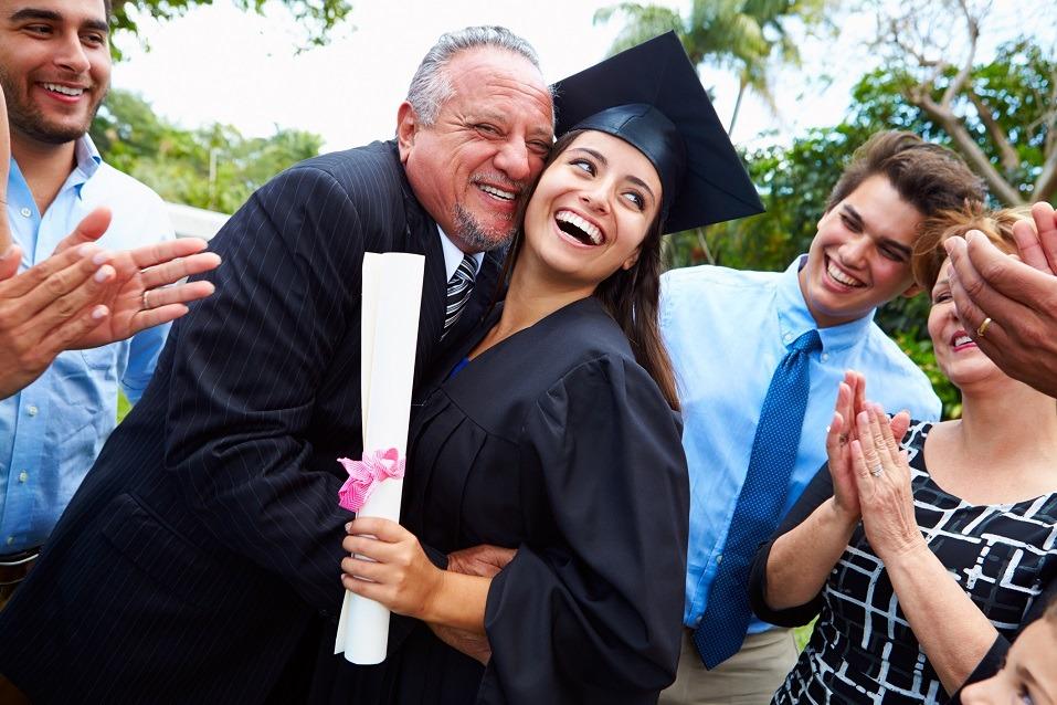 Hispanic Student And Family Celebrating